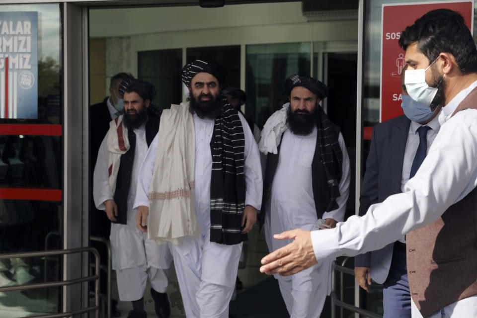 The Taliban delegation led by Amir Khan Muttaqi, the acting foreign minister, center, arrive at Esenboga Airport, in Ankara, Turkey, Thursday, Oct. 14, 2021. A high-level delegation of Afghanistan's new Taliban rulers has arrived in Turkey for talks with Turkish officials, the Foreign Ministry announced Thursday. The meetings in the capital of Ankara would be first between the Taliban and senior Turkish government officials after the group seized control of Afghanistan. (AP Photo/Burhan Ozbilici)