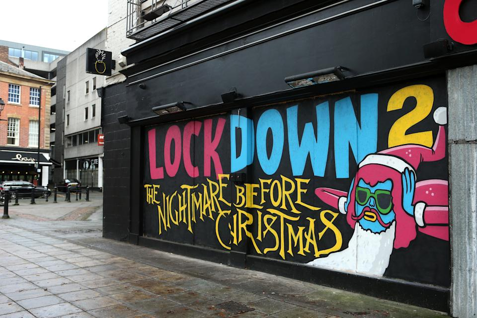 Street art that highlights the second lockdown is seen on the wall of Crazy Pedro's in Manchester (Getty Images)