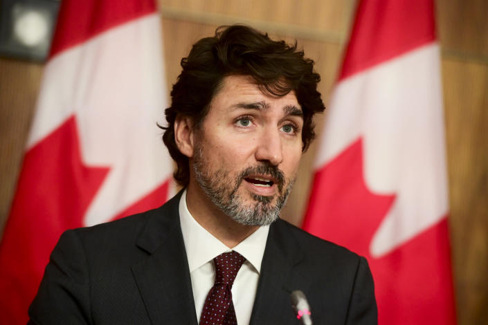 Canadian Prime Minister Justin Trudeau takes part in a press conference during the COVID-19 pandemic in Ottawa, Ontario, on Tuesday, Oct. 13, 2020. (Sean Kilpatrick/The Canadian Press via AP)
