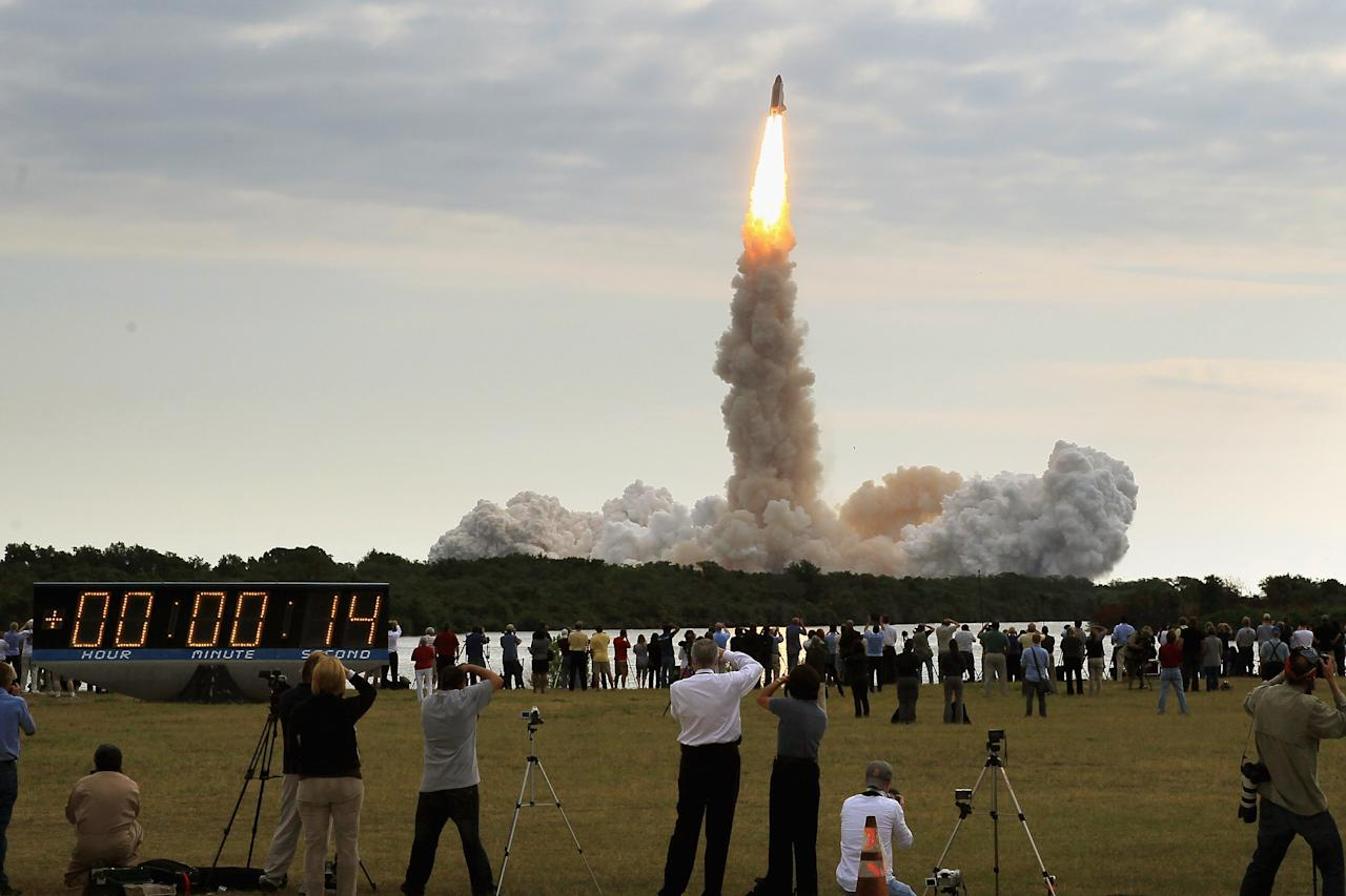 CAPE CANAVERAL, FL - MAY 16:  People watch as NASA space shuttle Endeavour lifts off from Launch Pad 39A at the Kennedy Space Center on May 16, 2011 in Cape Canaveral, Florida. After 20 years, 25 missions and more than 115 million miles in space, Endeavour is on its final flight to the International Space Station before being retired and donated to the California Science Center in Los Angeles. Mission STS-134 will deliver the Express Logistics Carrier-3 (ELC-3) and the Alpha Magnetic Spectrometer (AMS-2) to the International Space Station.  (Photo by Mark Wilson/Getty Images)