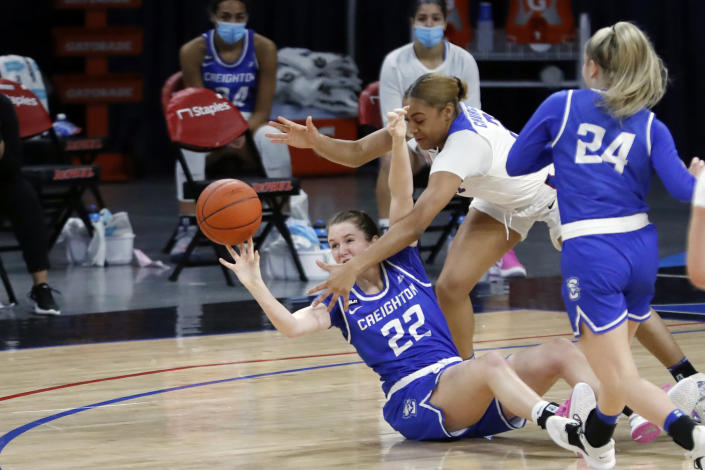 DePaul guard Deja Church, right, blocks the pass of Creighton 's Carly Bachelor during the first half of an NCAA college basketball game Saturday, Feb. 20, 2021, in Chicago. (AP Photo/Shafkat Anowar)