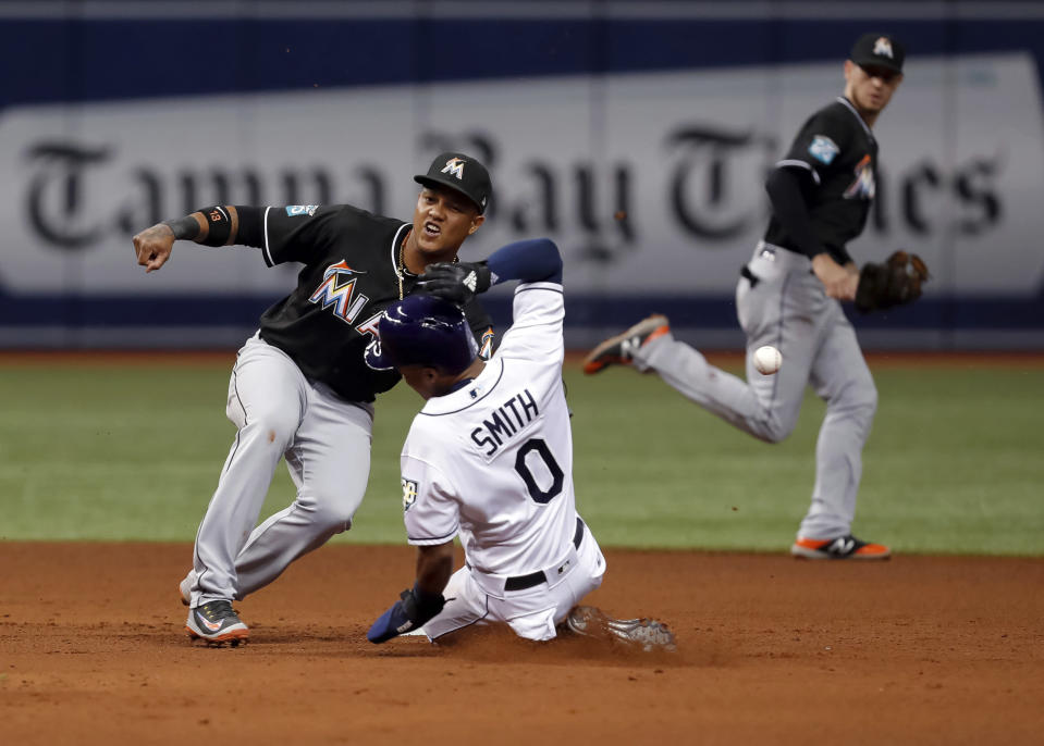 Tampa Bay Rays' Mallex Smith steals second base as the throw gets past Miami Marlins shortstop Miguel Rojas during the fifth inning of a baseball game Friday, July 20, 2018, in St. Petersburg, Fla. (AP Photo/Mike Carlson)