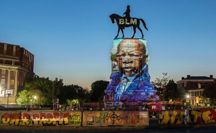 History rewritten... civil rights icon John Lewis projected on to Robert E Lee statue