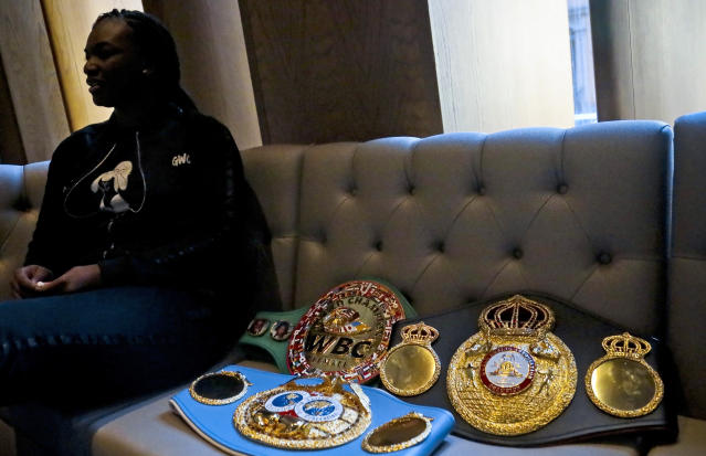 In this Feb. 26, 2019, photo, Claressa Shields sits next to her title belts, during an interview in New York for her middleweight championship boxing bout against Germany's Christina Hammer. (AP Photo/Bebeto Matthews)
