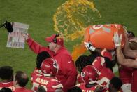 Kansas City Chiefs' players pour a cooler of Gatorade on head coach Andy Reid, during the second half of the NFL Super Bowl 54 football game against the San Francisco 49ers, Sunday, Feb. 2, 2020, in Miami Gardens, Fla. The Chiefs' defeated the 49ers 31-20. (AP Photo/Charlie Riedel)