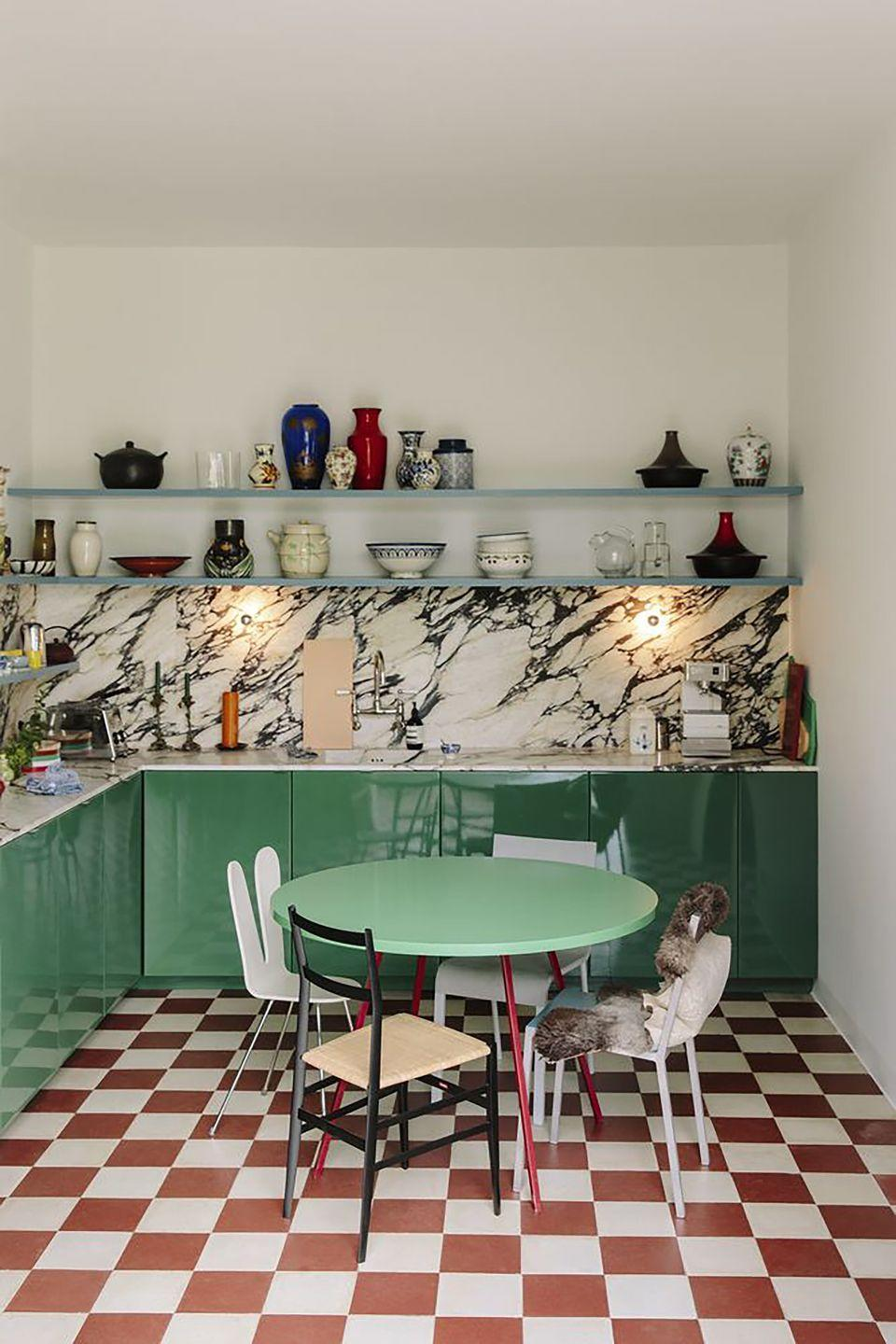 <p>With sea green enamel cabinets, richly veined marble and a red and white checkerboard floor that recalls a 1950s diner, this kitchen by Dutch design duo Muller Van Severen shows that just two hues can be enough to give a space a uniquely personal feel.</p>