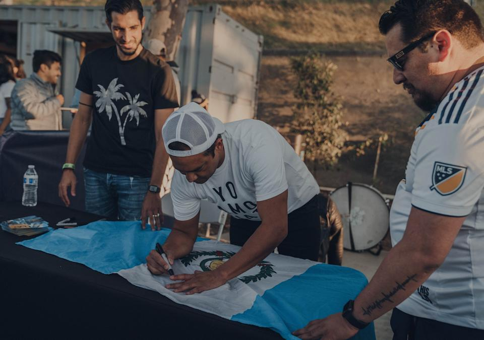 Fans get their merchandise signed at a recent LA Galaxy event. (Courtesy of Darwin Rosales/Darwin Visuals)