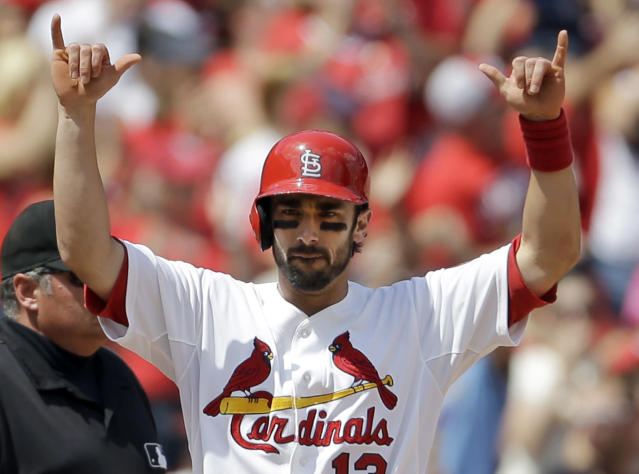 St. Louis Cardinals' Matt Carpenter celebrates after hitting an RBI triple during the fifth inning of a baseball game against the Pittsburgh Pirates on Thursday, Aug. 15, 2013, in St. Louis. (AP Photo/Jeff Roberson)