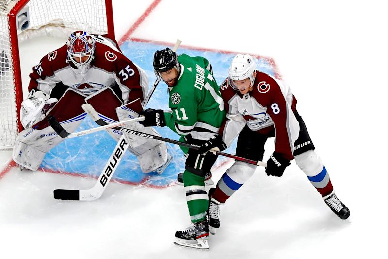 Dallas Stars center Andrew Cogliano (11) fights for position against Colorado Avalanche defenseman Cale Makar during the first period of Game 6.