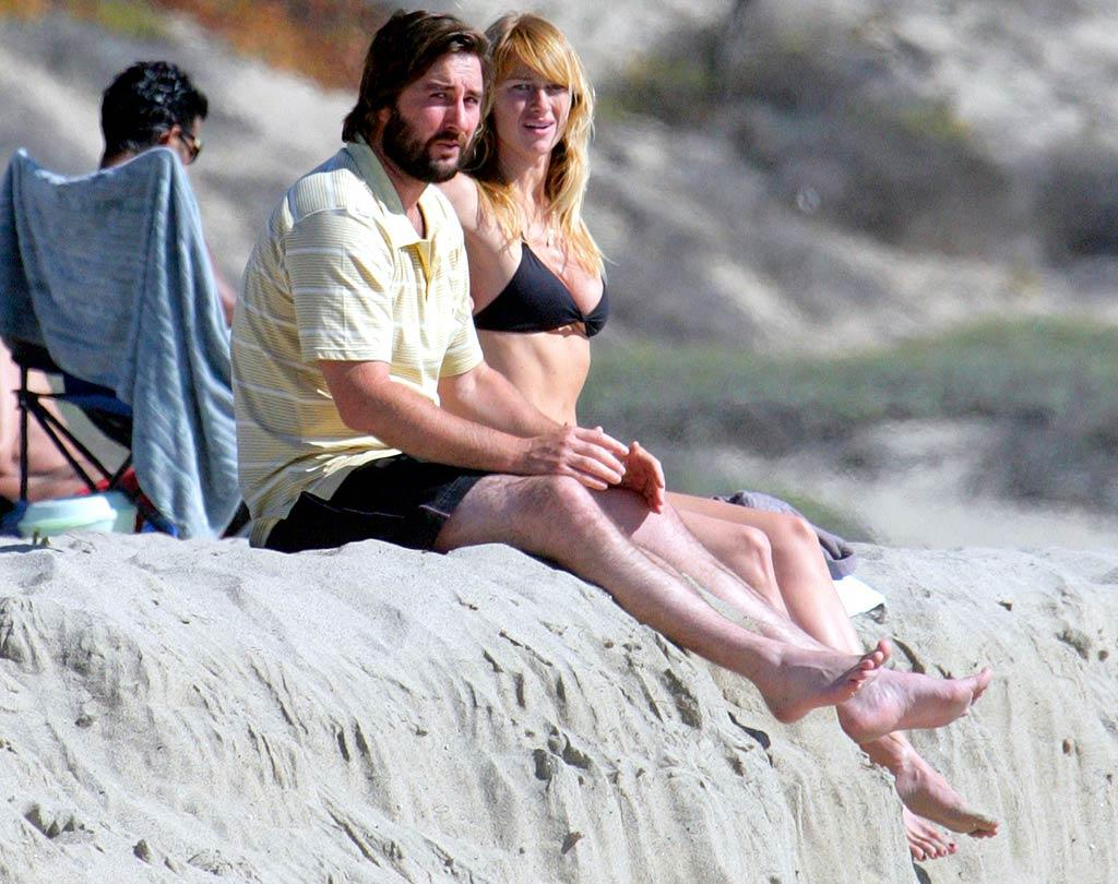 """Luke Wilson and his girlfriend catch some rays on a Malibu beach. Ginsburg-Spaly/<a href=""""http://www.x17online.com"""" target=""""new"""">X17 Online</a> - October 6, 2007"""