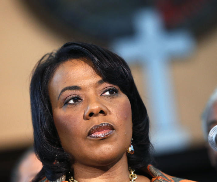 Bernice King speaks during a news conference at historic Ebenezer Baptist Church where her father Martin Luther King Jr. preached, Thursday, Feb. 6, 2014, in Atlanta. King is in a legal battle with her brothers over her father's Bible and Nobel Peace Prize medal. (AP Photo/John Bazemore)