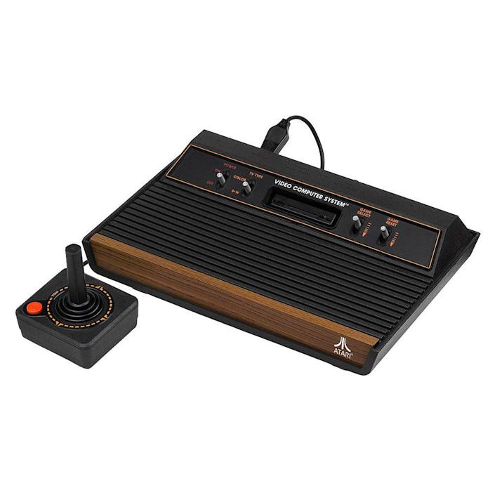 """<p><a class=""""link rapid-noclick-resp"""" href=""""https://www.amazon.com/Atari-2600-Video-Computer-System-Console/dp/B000X8EYQU?tag=syn-yahoo-20&ascsubtag=%5Bartid%7C10063.g.34738490%5Bsrc%7Cyahoo-us"""" rel=""""nofollow noopener"""" target=""""_blank"""" data-ylk=""""slk:BUY NOW"""">BUY NOW</a><br><br>The Atari 2600 gaming system launched in 1977. At first, it wasn't a huge success. Players were burnt out on <em>Pong</em> and lost interest in the $200 Video Computer System. It wasn't until the game <em>Adventure</em> was developed that sales for the Atari increased. <em>Adventure</em> was the first time a game had taken the player into a world bigger than the screen. Programmers started developing more adventure games, and by 1979, the Atari 2600 was the """"must-have"""" Christmas gift of the year.<br></p>"""