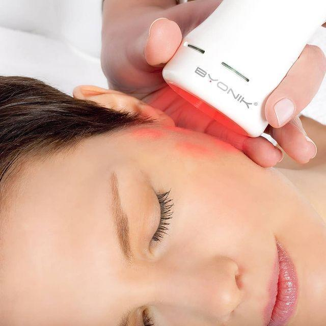 """<p>Non-invasive and pain-free, laser facial, Byonik, works with your pulse to release energy into your skin. The rejuvenation treatment can benefit all kinds of concerns, from scarring to redness, loss of elasticity, lines and wrinkles, granting all an instant glow plus anti-ageing effects over time. While every facial is individually customised to tackle your specific skin needs, expect a hydration hit, too. The laser delivers special hyaluronic gels to the the cells of the skin which increase volume and help define contours. A great all-rounder.<br></p><p>Byonik Pulse Triggered Laser at <a href=""""https://www.aesthetics-collective.co.uk/"""" rel=""""nofollow noopener"""" target=""""_blank"""" data-ylk=""""slk:Aesthetics Collective"""" class=""""link rapid-noclick-resp"""">Aesthetics Collective</a>, Sussex, Surrey & Hampshire, and <a href=""""https://skinhealthlondon.com/byonik"""" rel=""""nofollow noopener"""" target=""""_blank"""" data-ylk=""""slk:Skin Health London"""" class=""""link rapid-noclick-resp"""">Skin Health London</a></p><p><a href=""""https://www.instagram.com/p/BzfWLuEn8_5/?utm_source=ig_embed&utm_campaign=loading"""" rel=""""nofollow noopener"""" target=""""_blank"""" data-ylk=""""slk:See the original post on Instagram"""" class=""""link rapid-noclick-resp"""">See the original post on Instagram</a></p>"""