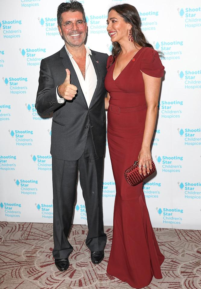 Simon Cowell and Lauren Silverman attend the Shooting Star Ball in Aid of Shooting Star Children's Hospices at Royal Lancaster Hotel in London on Friday night.