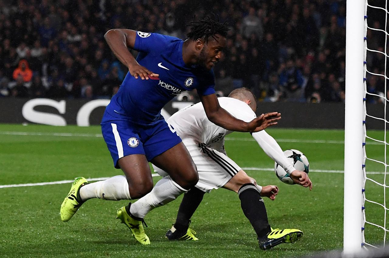 Soccer Football - Champions League - Chelsea vs Qarabag FK - Stamford Bridge, London, Britain - September 12, 2017   Chelsea's Michy Batshuayi in action with Qarabag's Maksim Medvedev who scores an own goal for the sixth goal     REUTERS/Dylan Martinez