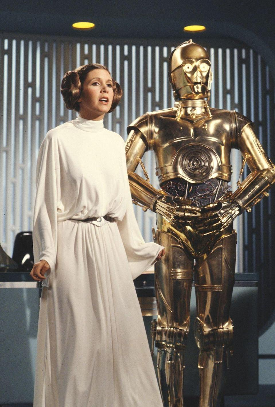 <p>Although this Princess Leia gown might be considered more costume than couture, with the draping fabric, billowing sleeves, and high neck, the <em>Star Wars</em> ensemble incorporates some of the biggest trends of the '70s—and it has rightfully earned a page in the pop culture history books. </p>