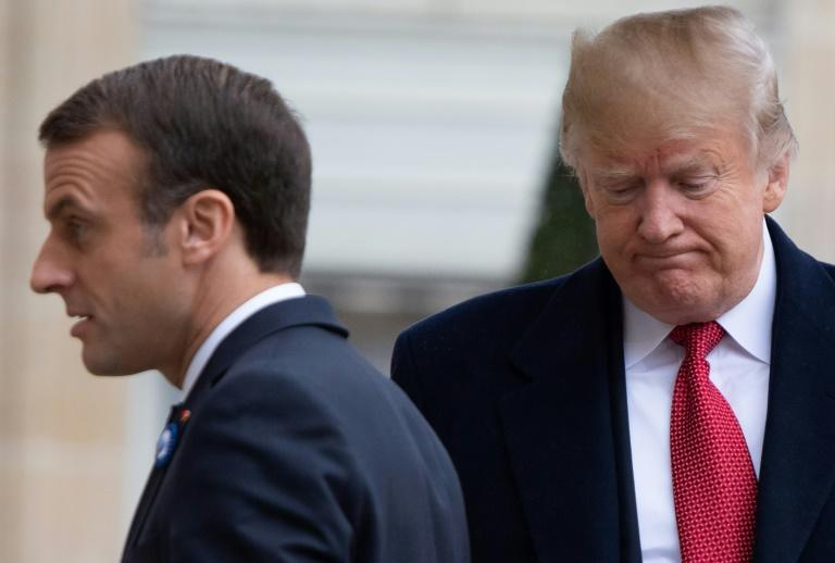US President Donald Trump (R), seen here during his November 10, 2018 visit to Paris, has again pressed French President Emmanuel Macron over trade and defense spending