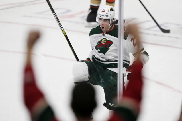 FILE - In this March 8, 2020, file photo, Minnesota Wild left wing Kevin Fiala, of Switzerland, reacts after scoring against the Anaheim Ducks during the overtime period of an NHL hockey game in Anaheim, Calif. Fiala's emergence as a go-to scorer before the NHL went on hiatus was the best part of the Minnesota Wild's season so far. (AP Photo/Alex Gallardo, File)