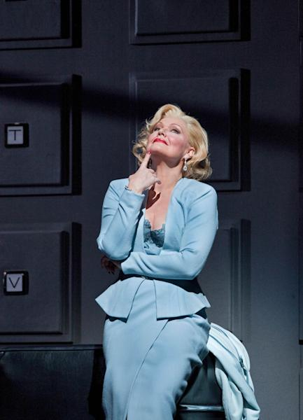 """In this April 18, 2012, photo provided by the Metropolitan Opera, Karita Mattila plays the 337-year-old Emilia Marty in Janacek's """"The Makropulos Case"""" during a rehearsal at the Metropolitan Opera in New York. """"The Makropulos Case"""" returned to the Met on Friday night, April 27, after an 11-year absence. (AP Photo/Metropolitan Opera, Cory Weaver)"""