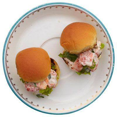 """<p>Downsizing traditional New England lobster rolls turns a little lobster meat into an appetizer a large group can enjoy.</p><p>Get the recipe from <a href=""""https://www.goodhousekeeping.com/food-recipes/a11238/lobster-sliders-recipe-rbk1211/"""" rel=""""nofollow noopener"""" target=""""_blank"""" data-ylk=""""slk:Good Housekeeping"""" class=""""link rapid-noclick-resp"""">Good Housekeeping</a>.</p>"""