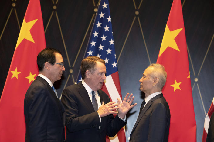 July 31, 2019, U.S. Trade Representative Robert Lighthizer, center, gestures as he chats with Chinese Vice Premier Liu He, right, with Treasury Secretary Steven Mnuchin. (AP Photo/Ng Han Guan, Pool, File)