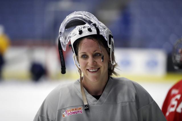 FILE - In this Dec. 15, 2016, file photo, United States forward Meghan Duggan smiles after hockey practice in Plymouth Township, Mich. Former Canadian women's hockey team forward Gillian Apps and American forward Meghan Duggan married this past weekend in Pownal, Maine. (AP Photo/Carlos Osorio, File)