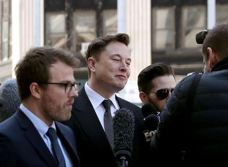 FILE PHOTO: Tesla CEO Elon Musk arrives at Manhattan federal court for a hearing on his fraud settlement with the Securities and Exchange Commission (SEC) in New York City, U.S., April 4, 2019.  REUTERS/Shannon Stapleton/File Photo