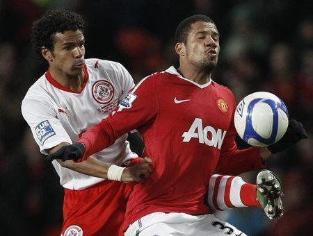 Manchester United's Bebe (R) is challenged by Crawley Town's Dean Howell during their English FA Cup soccer match at Old Trafford in Manchester, northern England February 19, 2011. REUTERS/Phil Noble/Files