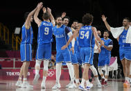 Italy players celebrate during men's basketball preliminary round game at the 2020 Summer Olympics, Sunday, July 25, 2021, in Saitama, Japan. (AP Photo/Eric Gay)