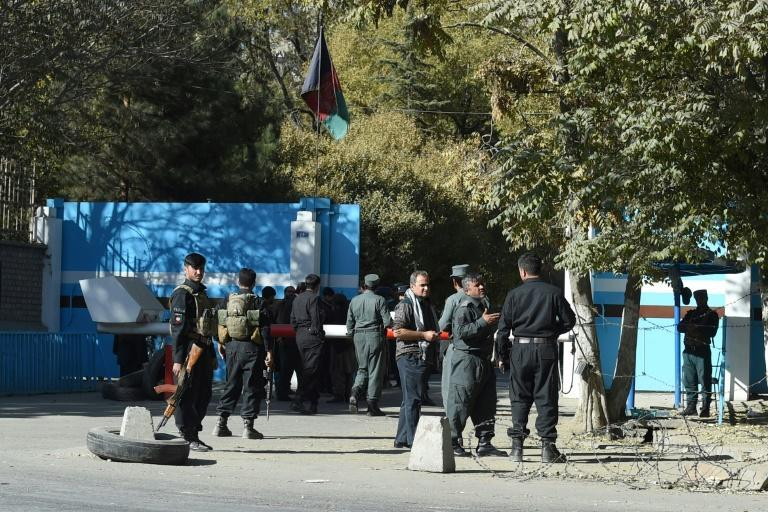 Police guard an entrance to Kabul University after gunmen stormed the campus