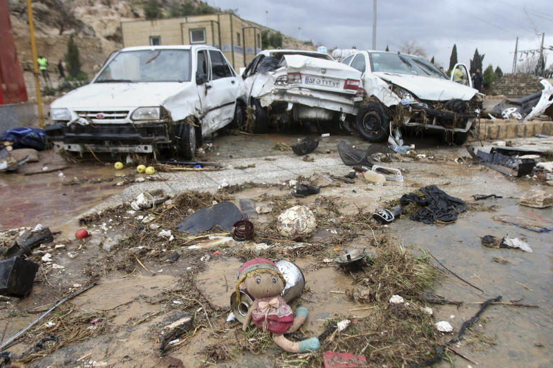 A child's doll lies in front of destroyed cars after a flash flood in the southern city of Shiraz, Iran, Monday, March 25, 2019. Flash floods in southern Iran have killed at least 17 people and injured scores, Iranian state TV reported on Monday. The northern provinces of Golestan and Mazandaran have been struggling with flooding for over a week, and five people have been killed, according to the state-run Press TV channel. (AP Photo/ISNA)