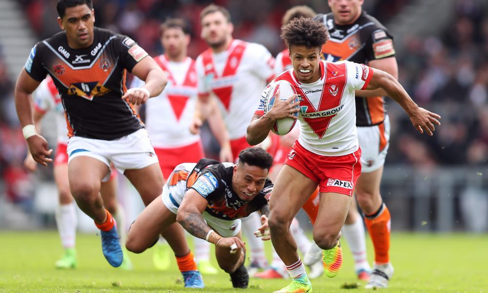 Regan Grace of St Helens gets away from Ben Roberts of Castleford Tigers in their Easter Monday meeting on Merseyside.