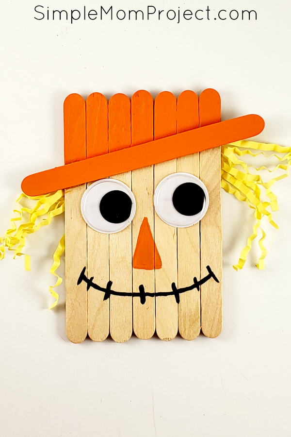 """<p>Popsicle sticks, googly eyes and crinkly yellow paper make a cute scarecrow. Once they're done crafting, tell your kids to dream up their own story about this cute scarecrow and his friends.</p><p><a href=""""https://simplemomproject.com/popsicle-stick-scarecrow/"""" rel=""""nofollow noopener"""" target=""""_blank"""" data-ylk=""""slk:Get the tutorial at Simple Mom Project »"""" class=""""link rapid-noclick-resp""""><em>Get the tutorial at Simple Mom Project »</em></a><br></p>"""