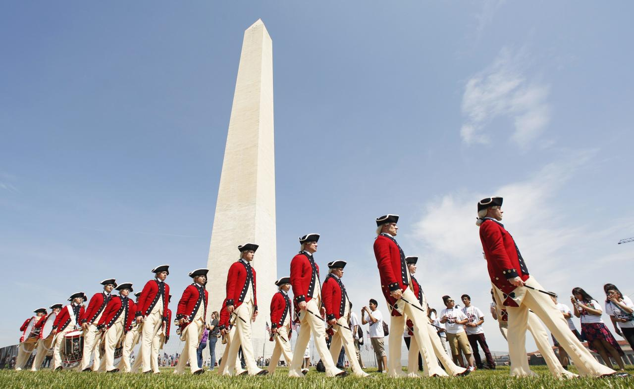 Members of the Fife and Drum Corps march during the re-opening ceremony for the Washington Monument in Washington May 12, 2014. The monument was closed in 2011 after it suffered widespread damage caused by a 5.8 magnitude earthquake along the East Coast. 