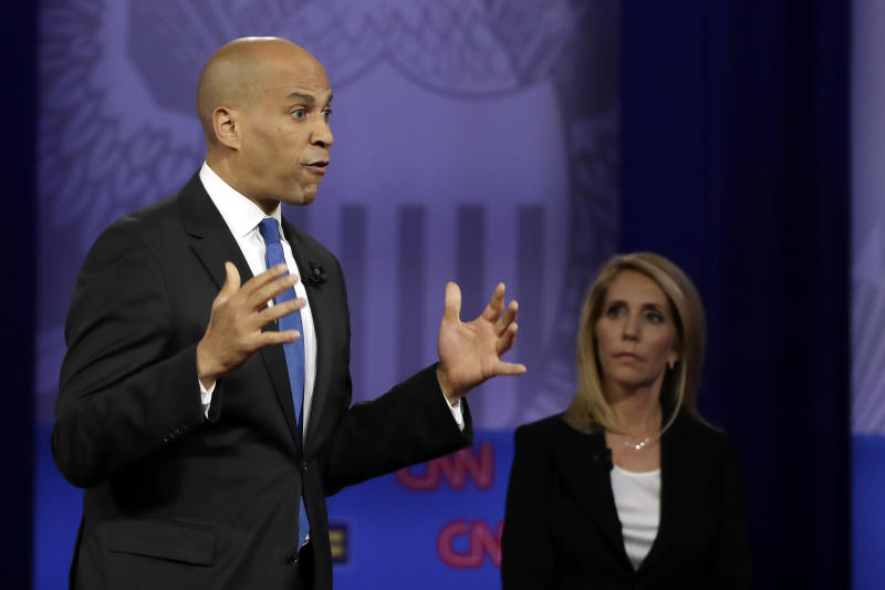 Democratic presidential candidate Sen. Cory Booker, left, D-N.J., speaks during the Power of our Pride Town Hall as with CNN moderator Dana Bash listens Thursday, Oct. 10, 2019, in Los Angeles. The LGBTQ-focused town hall featured nine 2020 Democratic presidential candidates. (AP Photo/Marcio Jose Sanchez)