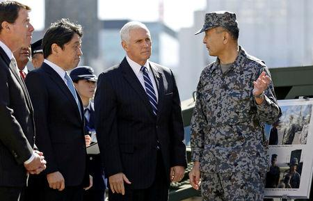 FILE PHOTO: U.S. Vice President Mike Pence speaks with a Japanese Ground Self-Defense Force officer as he inspects PAC-3 missile interceptors with Japan's Defense Minister Onodera at the Defense Ministry in Tokyo
