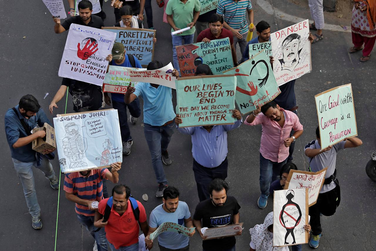 Students and teachers of Jawaharlal Nehru University (JNU) hold placards as they participate in a protest march demanding suspension of a professor accused of sexual harassment, in New Delhi, India, March 23, 2018. REUTERS/Saumya Khandelwal