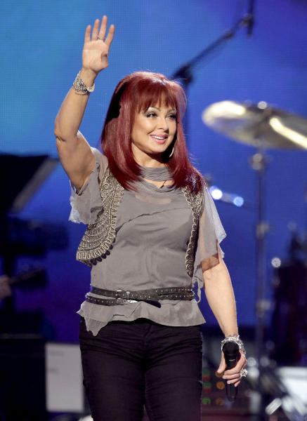 "FILE - In this April 4, 2011 file photo, country singer Naomi Judd performs at the Girls' Night Out: Superstar Women of Country in Las Vegas. Judd is hosting a limited-run talk show on SiriusXM called ""Think Twice."" Her first guest will be Ashley Judd, June 8. (AP Photo/Julie Jacobson, file)"
