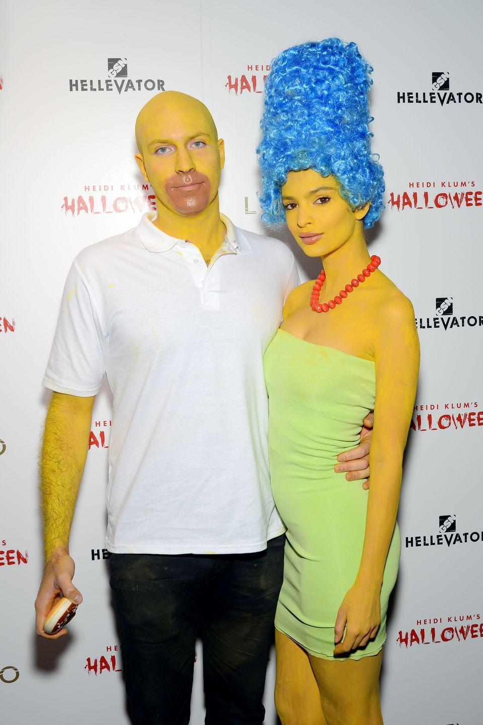 <p>In 2015, Emily Ratajowski and her then-boyfriend, Jeff Magid, donned yellow body paint to transform into the Simpsons for Halloween. They even brought their own donut. </p>