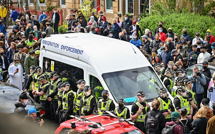 Hundreds of residents, including politicians, took to the streets in Glasgow to protest the attempted removal - Getty Images Europe