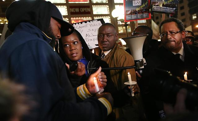 NEW YORK, NY - FEBRUARY 26: Tracy Martin (L) and Sybrina Fulton (2nd L), Trayvon Martin's parents, attorney Benjamin Crump (2nd R) and author Michael Eric Dyson (R) attend a candlelight vigil for Martin in Union Square on February 26, 2013 in New York, New York. Vigils were held in Florida and New York on the one year anniversary of teenager Trayvon Martin's shooting death by George Zimmerman in Florida. (Photo by Mario Tama/Getty Images)