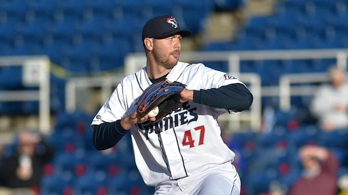 Tylor Megill winds up before pitch in Double-A