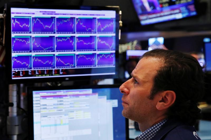 A trader works on the floor of the New York Stock Exchange (NYSE) in New York