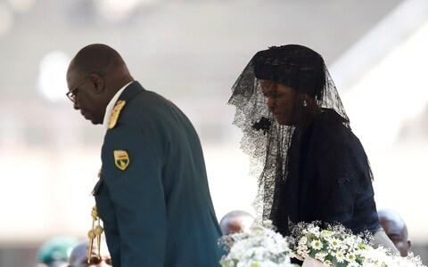 Grace Mugabe walks to pay her last respects to her late husband - Credit: SIPHIWE SIBEKO/Reuters