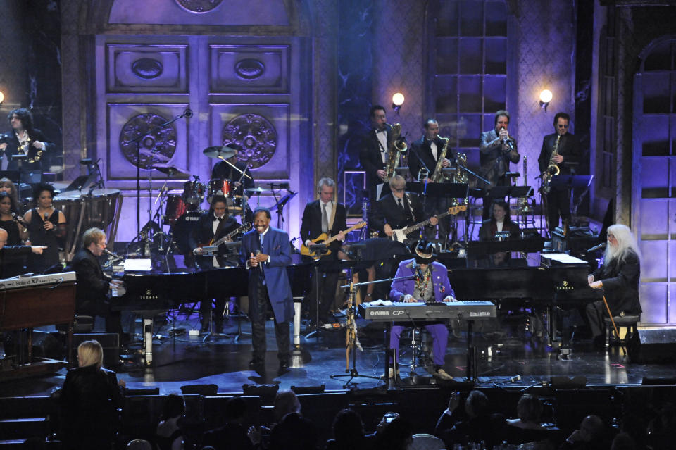 """FILE - In this March 15, 2011 file photo, from left, Elton John, Lloyd Price, Dr. John, and Leon Russell perform at the Rock and Roll Hall of Fame induction ceremony in New York. The New Orleans mainstay and Rock and Roll Hall of Famer has died. Price was known for such hits as """"Lawdy Miss Clawdy"""" and """"Stagger Lee."""" His wife Jackie said he died Monday, May 3, 2021 in New Rochelle, N.Y. (AP Photo/Evan Agostini, File)"""