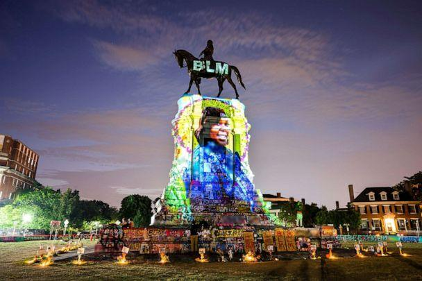 PHOTO: A photograph of Breonna Taylor, who was killed in her own apartment by Louisville, Kentucky police officers, is projected onto a statue of Confederate General Robert E. Lee in Richmond, Va., July 6, 2020. (Jim Lo Scalza/EPA via Shutterstock)