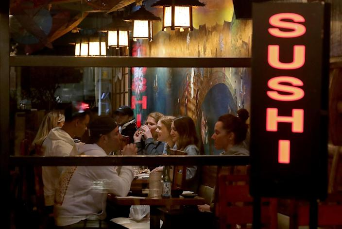 Customers dine inside a sushi restaurant in Long Beach.