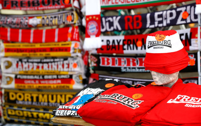 Soccer supporter scarves are on display for sale outside the Schwarzwald stadium of German Bundesliga soccer club SC Freiburg in Freiburg, Germany, May 12, 2018. REUTERS/Kai Pfaffenbach