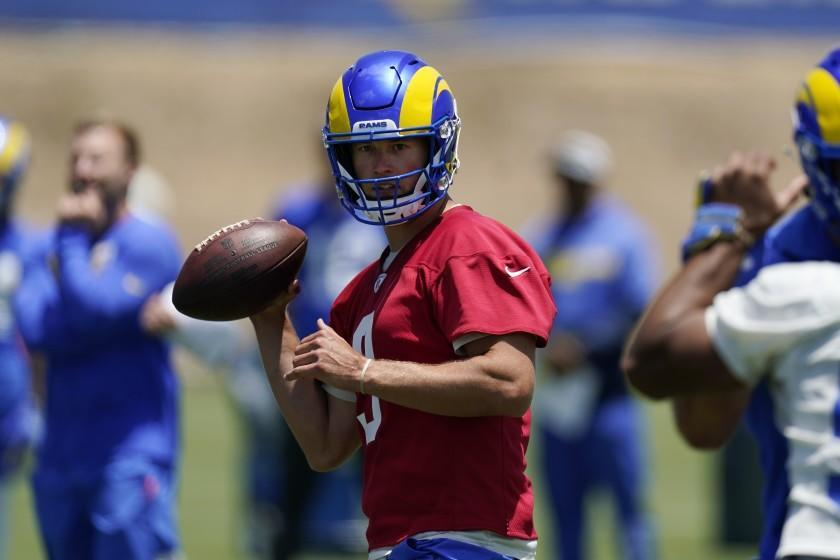 Los Angeles Rams quarterback Matthew Stafford fakes a pass during an NFL football practice Tuesday, June 8, 2021, in Thousand Oaks, Calif. (AP Photo/Mark J. Terrill)