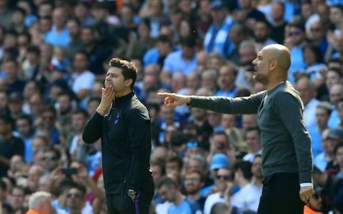 Tottenham Hotspur's Argentinian head coach Mauricio Pochettino (L) and Manchester City's Spanish manager Pep Guardiola look on during the English Premier League football match between Manchester City and Tottenham Hotspur at the Etihad Stadium in Manchester - Credit: AFP